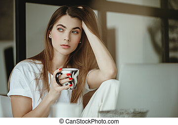 Woman with mug in hand.