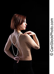 Woman with naked spine and pearl beads