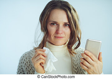 woman with napkin ordering pills in pharma online shop