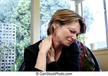neck pain - woman with neck pain