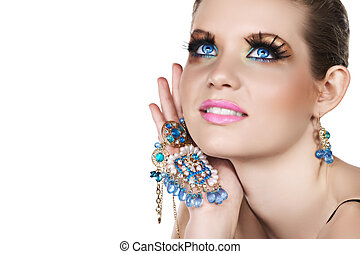 woman with necklace - Blond woman with long false lashes...