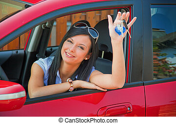 Woman with new car and car keys - Young Woman with a new car...
