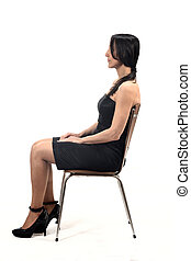 woman with off shoulder dress look side sitting on a chair isolated on white