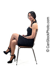 woman with off shoulder dress serious sitting on a chair isolated on white
