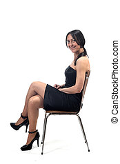 woman with off shoulder dress smiling sitting on a chair isolated on white