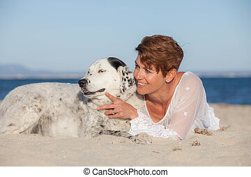 woman with old pet mongrel dog