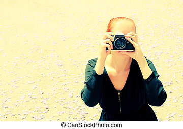 woman with old vintage camera outdoors
