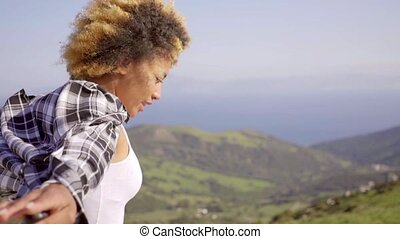Woman with Open Arms on Coastal Hill Top - Waist Up of Young...