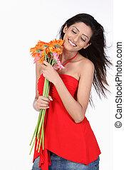 woman with orange daisy flowers