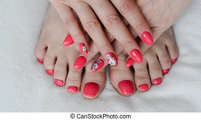 Woman with orange manicure and pedicure - Woman with an...