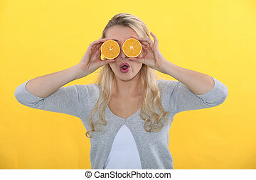 Woman with oranges for eyes