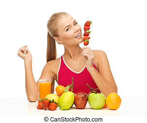 woman with organic food eating strawberry