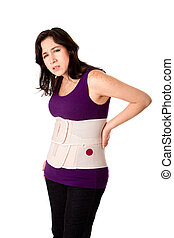 Woman with orthopedic body brace - Woman in pain from back...