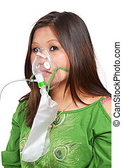 Woman with Oxygen Mask - A beautiful young woman wearing an...