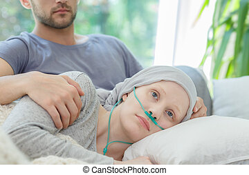 Woman with oxygen nasal cannula