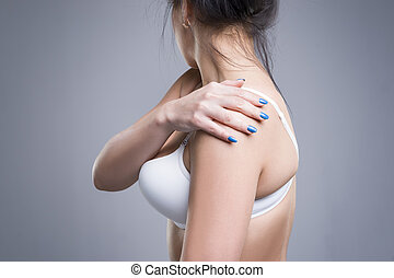 Woman with pain in shoulder, ache in the human body