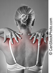 Woman with pain in shoulders. Pain in the human body with red dot
