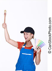 Woman with paint brush and swatch