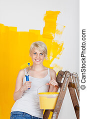 Woman With Paint Roller And Bucket