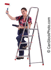 Woman with paint roller and step-ladder