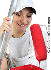 Woman with paint roller