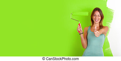 Woman with painting roller.