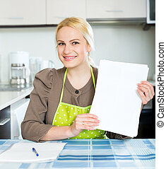 woman with paper at home