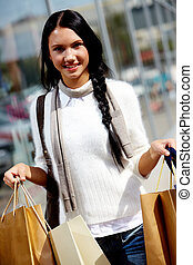 Woman with paperbags - Image of happy female with paperbags...