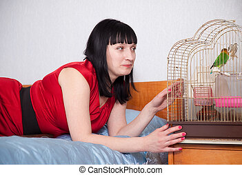 woman with  parrot at home