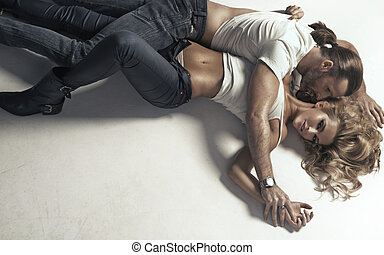 Woman with perfect body hugged by man