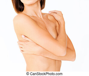 woman with perfect skin and hands over breast - health,...
