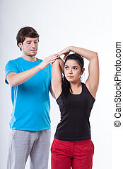 Woman with personal trainer - Woman doing rehabilitation...