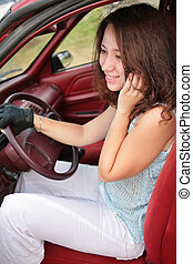woman with phone in car