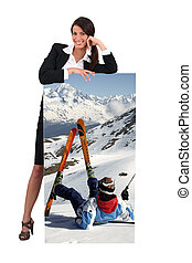 Woman with picture of skier