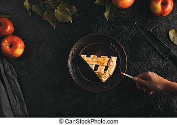 woman with piece of apple pie