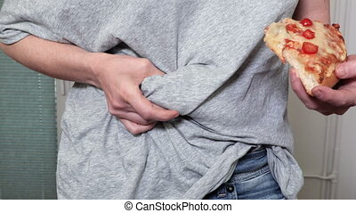 Woman with piece of pizza.Unhealthy eating concept