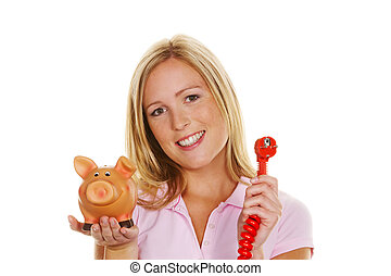 Woman with piggy bank and power plug - A young woman holding...