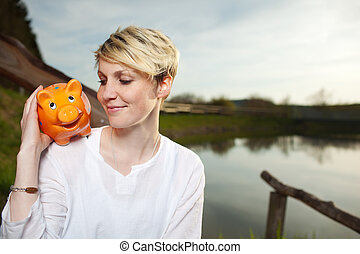 Woman With Piggy Bank Outdoors