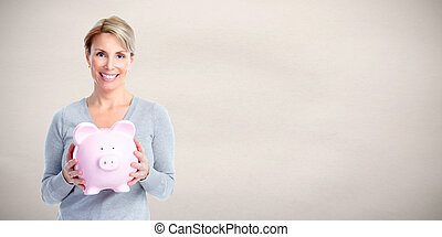 Woman with piggy bank. - Caucasian smiling casual lady with...