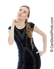 Woman with pigtail in black dress thinking. Isolated on white.