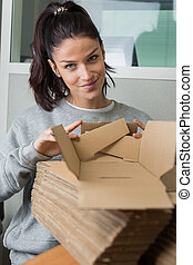 woman with pile of boxes