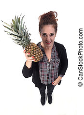 woman with pineapple on white background