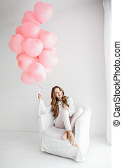 Woman with pink baloons - Young beautiful woman smiling and...