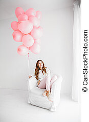 Woman with pink baloons