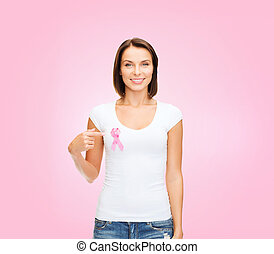 woman with pink cancer awareness ribbon - healthcare and...