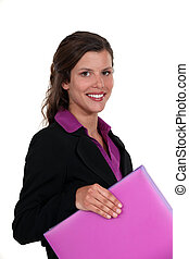 Woman with pink folder in hand