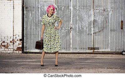 Woman with Pink Hair and a Small Siuitcase
