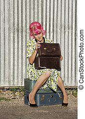 Woman with Pink Hair and a Small Siuitcases