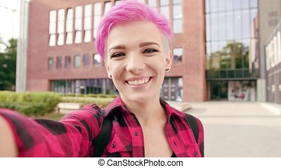 Woman with Pink Short Hair Making a Video Call
