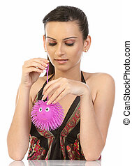Woman with pink soft toy
